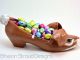 Side View of Brown Bunny Shoe Sculpture with Candy